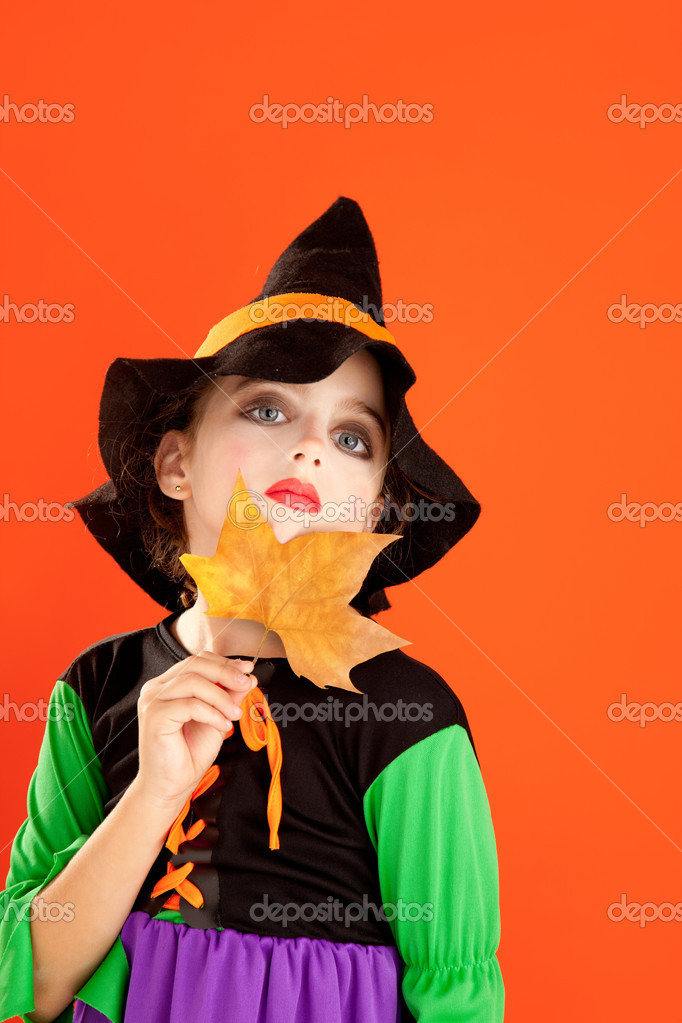 Halloween kid girl costume on orange background — Stock Photo #7093108