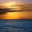 Golden sunrise with sun and clouds over sea — Stock Photo #7107833