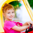 Blond children girl driving toy car — Stock Photo