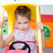 Angry toy car driver children girl — Stock Photo