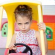Angry toy car driver children girl - Foto de Stock