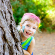 Stock Photo: Children little girl happy playing in forest tree