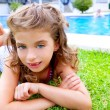 Children girl lying on pool grass in summer — Stock Photo