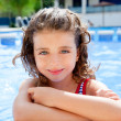 Happy kid girl smiling at swimming pool — Stock Photo