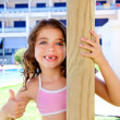 Indented kid girl ok gesture in pool garden — Stock Photo #7109933