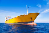 Anchor cargo yellow boat in blue sea — Stock Photo