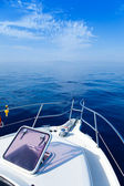 Blue sea boat sailing with open bow porthole — Stock Photo