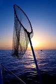 Dip net in boat fishing on sunrise saltwater — Stock Photo