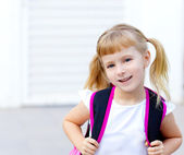 Children little girl going to school with bag — Stock Photo