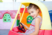 Children girl driving a toy car — Stock Photo