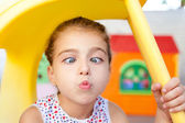 Cross eyed squinting expression little girl — Stock Photo