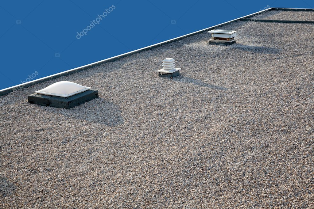 inverted gravel roof chimney and skylight stock photo lunamarina 7113076. Black Bedroom Furniture Sets. Home Design Ideas