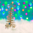 Christmas wire tree on white fur and lights — Stock Photo