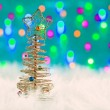 Royalty-Free Stock Photo: Christmas wire tree on white fur and lights
