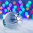 Christmas babule in silver with tree and lights — Stock Photo