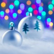 Stock Photo: Christmas silver baubles witn tree and lights