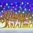 Merry christmas written in gold with lights - Stockfoto