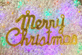 Merry christmas written in gold over ice — Stock Photo