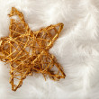 Christmas golden star over white fur - Stok fotoğraf