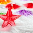 Christmas glass star over winter white fur — Stock Photo