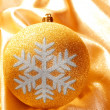 Christmas glitter golden snowflake bauble - Stockfoto