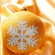 Christmas glitter golden snowflake bauble - Stock Photo