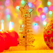 Christmas golden tree baubles and candles - Photo