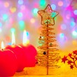 Christmas golden tree baubles and candles — Stock Photo #7230770