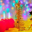 Christmas golden tree baubles and candles - Foto de Stock