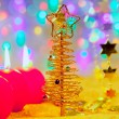 Christmas golden tree baubles and candles — Stock Photo