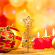 Stock Photo: Christmas golden tree baubles and candles