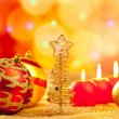 Christmas golden tree baubles and candles - Stock Photo