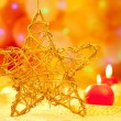 Christmas golden star candles in blurred lights - Zdjęcie stockowe