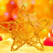 Christmas golden star candles in blurred lights — Stock Photo #7230986
