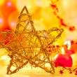 Christmas golden star candles in blurred lights — Stock Photo #7231022