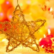 Christmas golden star candles in blurred lights - Foto Stock