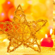 Christmas golden star candles in blurred lights - Stok fotoğraf