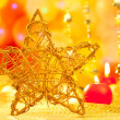 Christmas golden star candles in blurred lights - Stockfoto