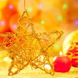 Christmas golden star candles and baubles - Stockfoto