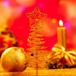 Christmas golden tree babubles and candles — Stock Photo