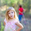 Blond kid girl in forest park — Stock Photo #7231673