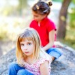 Friends kid girls playing in forest rock — Stock Photo #7232776