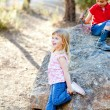 Friends kid girls playing in forest rock — Stock Photo #7233013