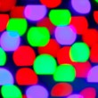 Royalty-Free Stock Photo: Glowing bokeh colorful lights in black