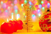 Christmas golden red baubles in blur lights — Stock Photo