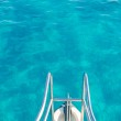 Boat bow in transparent turquoise water — Stock Photo