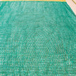 Green and yellow fishing net on the floor - Stok fotoraf
