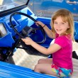 Blond little girl driving in convertible — Stock Photo