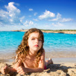 Beautiful little girl in sandy beach of Ibiza — Stock Photo