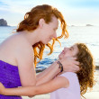 Royalty-Free Stock Photo: Daughter and mother hug on the Ibiza beach